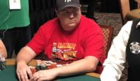 Shaun Deeb sitting at a poker table.