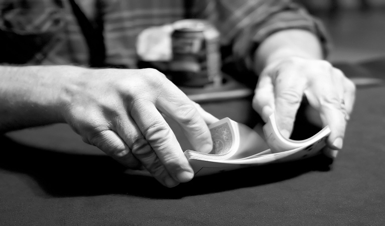 A player shuffling cards.