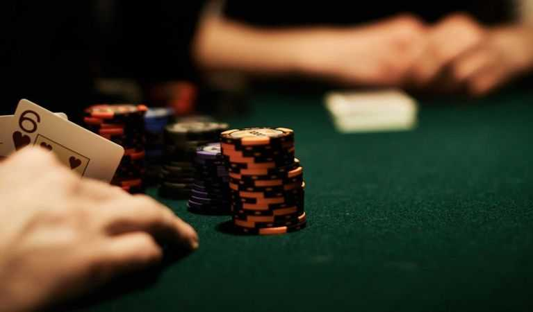 A poker player hiding their cards.