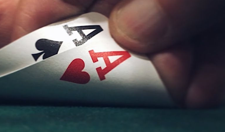Poker hand with aces.