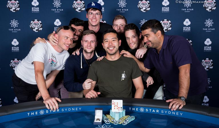 Matthew Wakeman posing with the rest of the final table
