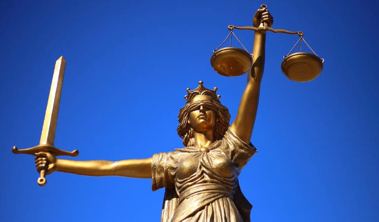 Justice ruling with her scales
