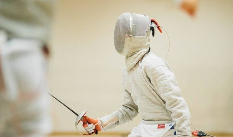 A man holding a sabre fencing