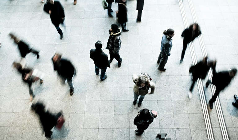 Pedestrians walking in a square.