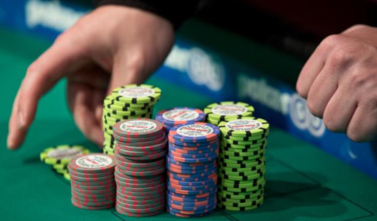 Poker-chips-and-a-croupier's-hands-at-a-wsop-tournament