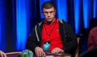 Tsoukernik sitting at a poker table while game is afoot