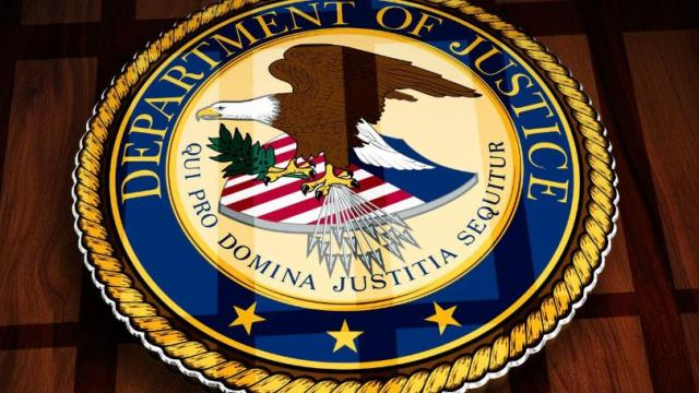Department of Justice official logo and motto.