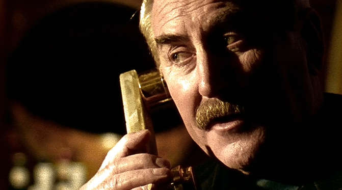 Harry Hatchett, the villain from Lock, Stock and Two Smaking Barrels, on the phone.