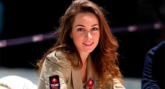 Liv Boeree playing poker with her PokerStars jacket on.