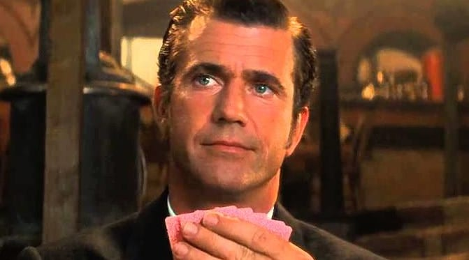 Mel Gibson playing his hands in The Maverick