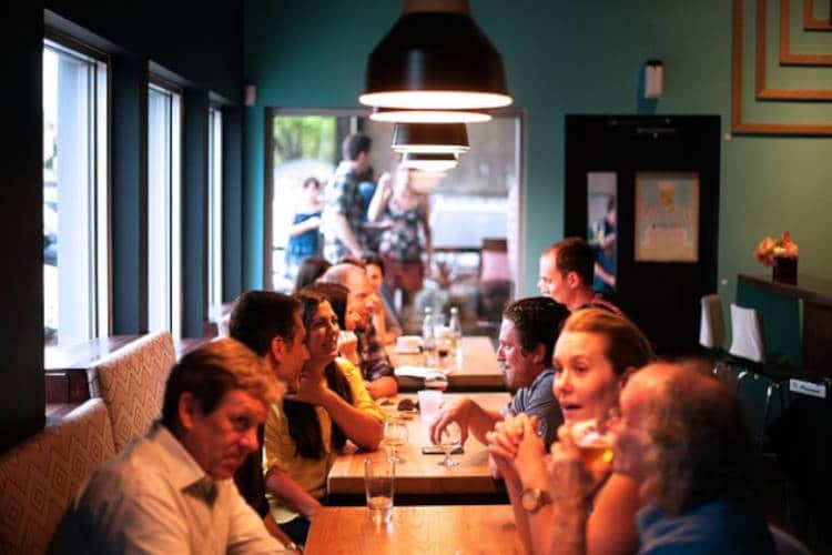 People at a table in a restaurant.