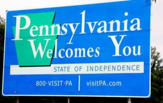 A sign in Pennsylvania welcoming people