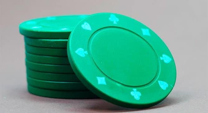 Green poker chips waiting to be played.