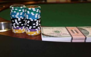 A picture of casino chips and dollar bills
