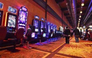 People walking on a casino floor.