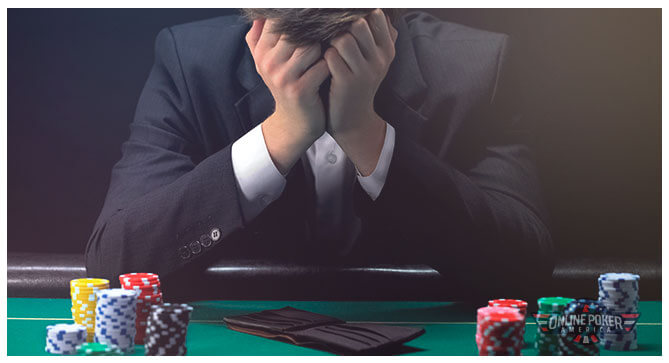 Image of Hijack seat player holding their head in their hands.