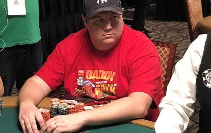 Shaun Deeb sitting at a poker table.