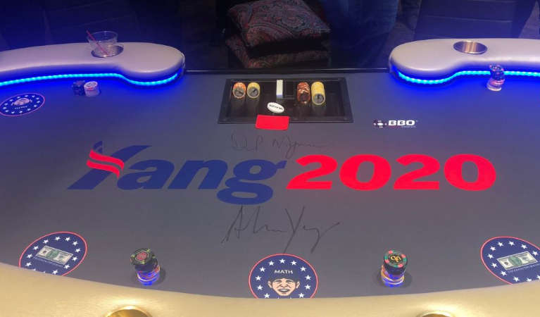 A poker table with Andrew Yang's campaign table