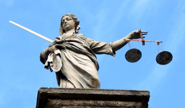 The picture represents a statue of lady justice in Dublin.