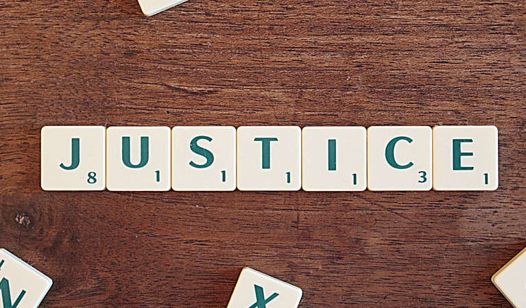 justice spelt with scrabble letters