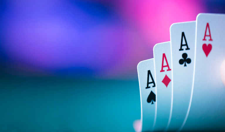 four-aces-in-poker-raised-so-that-the-player-can-see-them